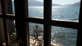 Sea view from the window of a cafe. Sea view from the window of a cafe in Montenegro stock video