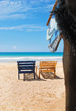 Sea view, wood chairs on the beach. Sea view, couple of wood chairs on the beach, Mirissa, Sri Lanka royalty free stock photography