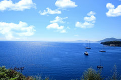 Sea view. Yacht at sea. Dark blue ionian sea Royalty Free Stock Photos