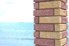 Sea viewed through window of stone wall. Black sea behind the column stock image