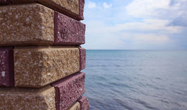 Sea viewed through window of stone wall. Black sea behind the column Royalty Free Stock Image