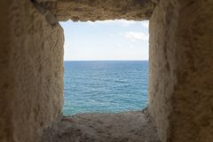 Sea views from the loopholes. The fortress of Fortezza Royalty Free Stock Photos