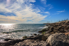 Sea views. Next the beach and the breakwater Royalty Free Stock Photos