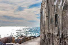 Sea views. Next the beach and the breakwater Royalty Free Stock Photography