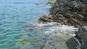 Sea and volcanic rock stock video footage