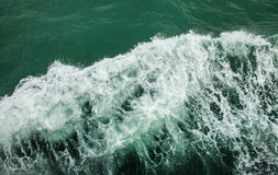 Sea in wake of boat Stock Images
