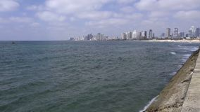 The sea wall near the city of Tel Aviv. Scene of the sea wall near the city of Tel Aviv stock video