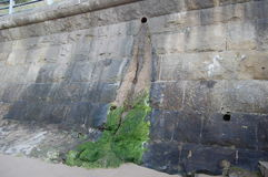 Sea wall outfall Stock Images