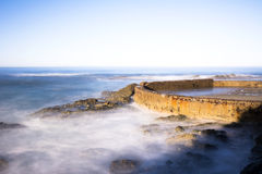 Sea wall protecting beach Stock Photography