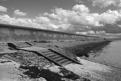 Sea wall at Thorney Bay, Canvey Island, Essex, England Stock Image