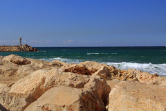 Free Sea Wall With Small Lighthouse On The Mediterranean Sea In Herzliya Israel Stock Photo - 43442190