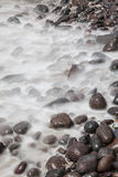 Sea washing over rocks Stock Photo