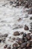 Sea washing over rocks Stock Photo