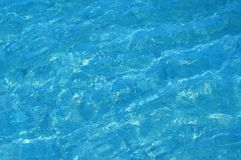 Sea water. Beautiful blue rippled sea water surface with sun reflections Stock Images