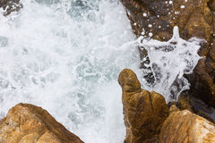 Sea water against the rocks and cliffs. Royalty Free Stock Photography
