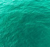 Sea water background in turquoise color. Sea water background in saturated turquoise color royalty free stock images