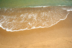 Sea water on the beach sand Stock Photography