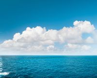 Sea water blue sky white clouds Nature landscape. Sea water and perfect blue sky with white clouds. Nature landscape Royalty Free Stock Image