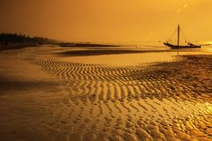 Sea Water With Boat during Sunset Royalty Free Stock Photography