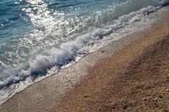 Sea water breaking the beach stock image