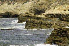 Sea Water Breaking on Rock Formations. Ocean water breaking against jetting rocks Royalty Free Stock Images