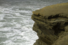 Sea Water Breaking on Rock Formations. Ocean water breaking on cliff rocks Stock Photos