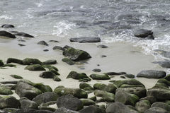 Sea Water Breaking on Rock Formations Royalty Free Stock Image