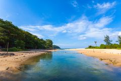 Sea water in canal from the sea flow down the sea. When low tide at Nai Harn beach Phuket stock photography