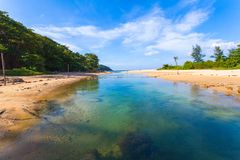 Blue water in canal flow down to the sea. Sea water in canal from the sea flow down the sea when low tide at Nai Harn beach Phuket royalty free stock image