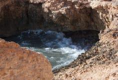 Sea water eroding heart shaped cavity Royalty Free Stock Photography