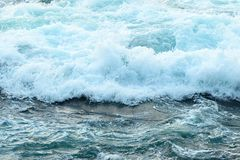 Sea water with foam. Top view sea texture. Nature wallpaper. Ocean waves, water from top view, pattern background ocean royalty free stock images