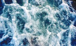 Sea water with foamy wave. Tropical islands boat travel. Cruise ship trail. Azure ocean surface top view. Big ship foamy trail. Motor boat tail on seawater Royalty Free Stock Image
