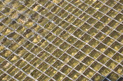Sea water with grid n the port Royalty Free Stock Photo