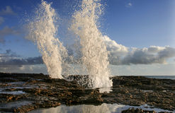 Sea water jets on Cadiz coastline rocks, Spain Stock Image