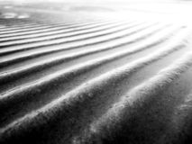 Sea water pattern on the sand after tide. Black and white royalty free stock image