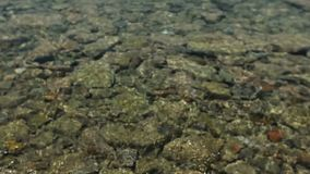 Sea water on the pebbles. Close up shot of the sea water on the pebbles. Greece stock video footage