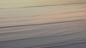 Sea water ripples at sunrise stock video footage