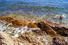 Sea water and rocks. Royalty Free Stock Photography