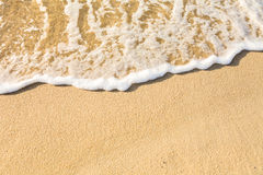 Sea water and sand Stock Photos