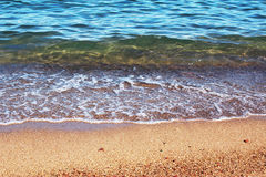 Sea water and sand background Stock Photo