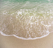 Sea water and sand beach Royalty Free Stock Photo