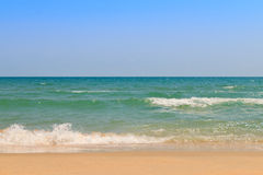 Sea water sky and sand Stock Photos