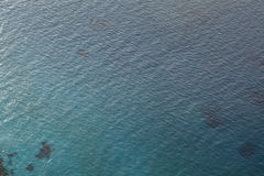 Sea water smooth surface, ocean reflection sun, view above water 40 meter Royalty Free Stock Photo