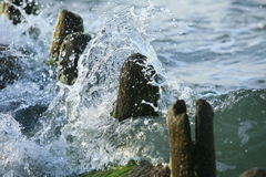 Sea water splash. On pier Royalty Free Stock Photography