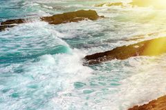 Sea water splash with foamy wave. Water surface texture. Stock Images