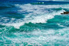 Sea water splash with foamy wave. Water surface texture. Royalty Free Stock Photography