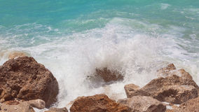 Sea water splashes on the rock, close up Stock Photography