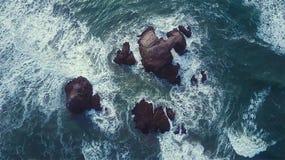 Sea water splashing against rocks Royalty Free Stock Photo