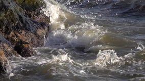 Sea water splashing on the rocks. Ocean waves splashing on the rocks on the shore. Sea Water Splashing On The Rocks stock video footage