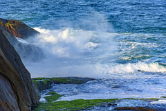 Sea water spray over the stones Royalty Free Stock Photo